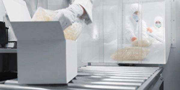 Medical products being boxed up on a conveyor belt