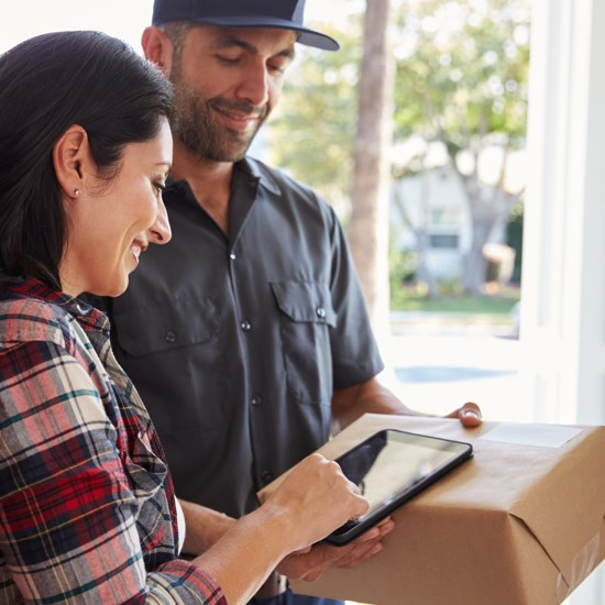 Woman signing for package delivery