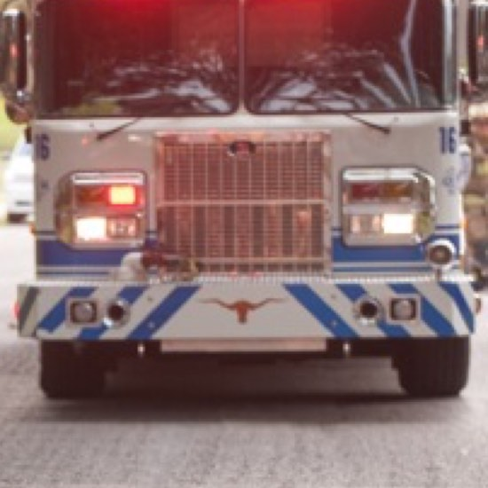 Front of large EMS truck on the road