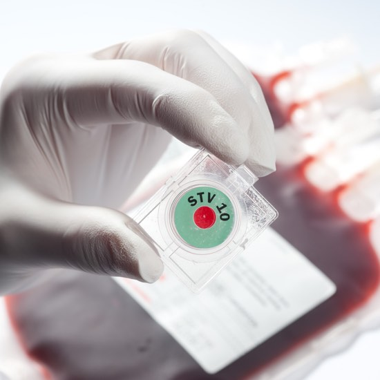 Safe-T-Vue being held in front of blood bags