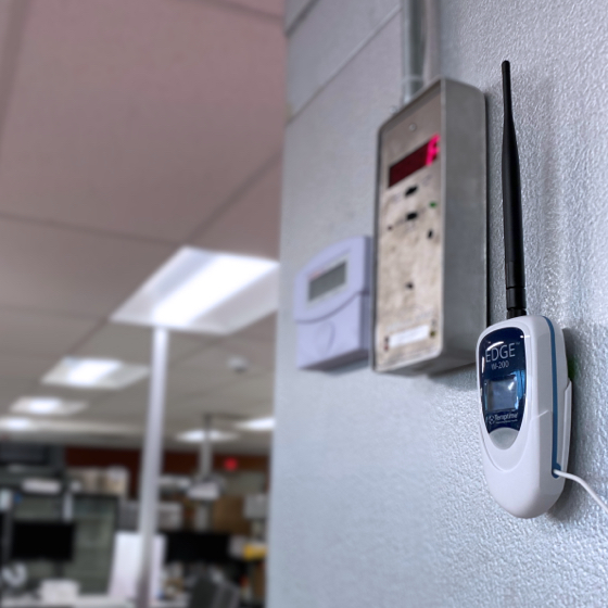 W-200 wireless sensor mounted to the outside of a commercial freezer