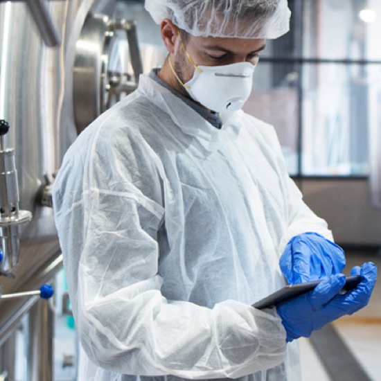 Worker in pharmaceutical manufacturing facility