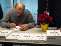 Dr. Kartoglu signing books for Temptime employees and guests